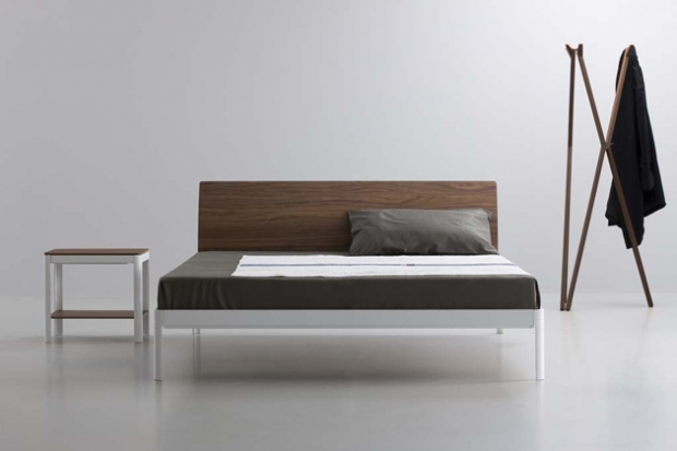 Plane bedframe with walnut headboard. Designed by Luciano Bertoncini